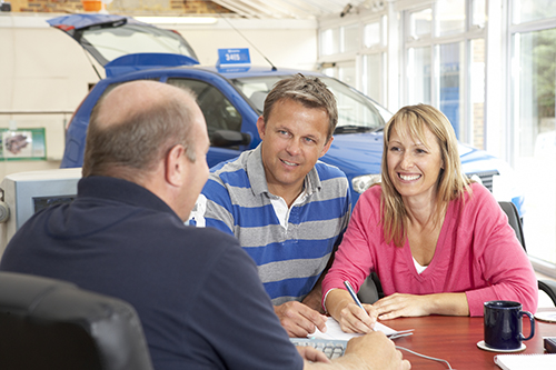 bigstock-Couple-filling-in-paperwork-in-13903022SM