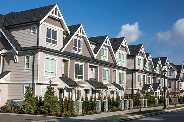 bigstock-Modern-Townhouses-53248210SM