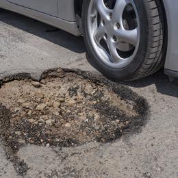 pothole car