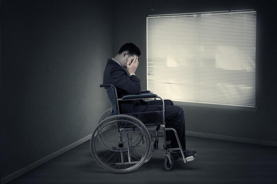 bigstock-Disabled-Businessman-Sitting-N-93291578.jpg