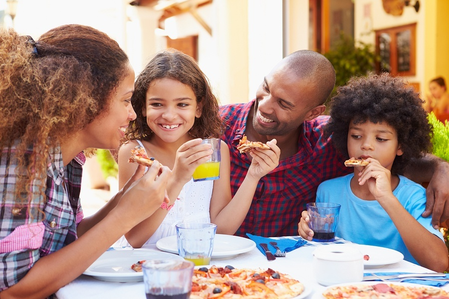 bigstock-Family-Eating-Meal-At-Outdoor--78353786.jpg