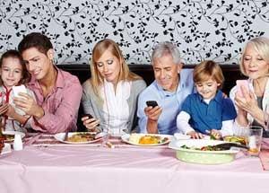 bigstock-Family-looking-at-their-smartp-52333183.jpg