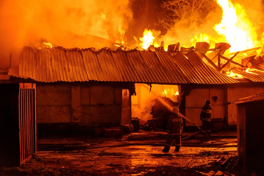 bigstock-Firefighters-extinguish-a-fire-184399981.jpg
