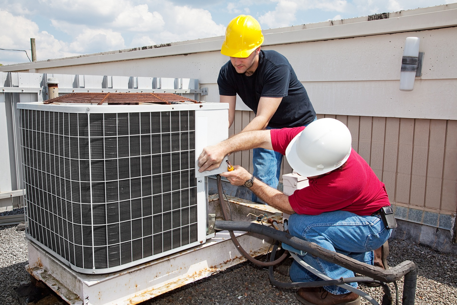 bigstock-Two-workers-on-the-roof-of-a-b-11990135.jpg