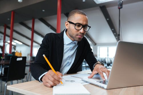 young african american businessman on laptop