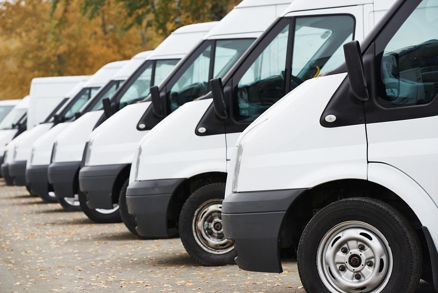 bigstock-commercial-delivery-vans-in-ro-61615427.jpg