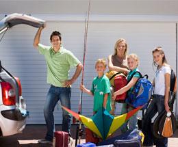 family-loading-up-car