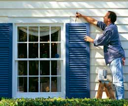 man-painting-house